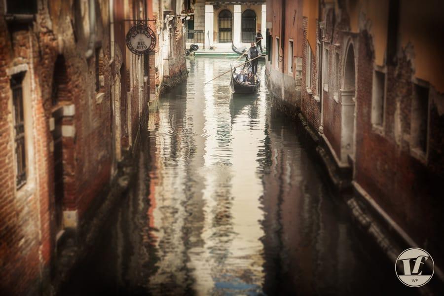 Couple photograph on a gondola in Venice